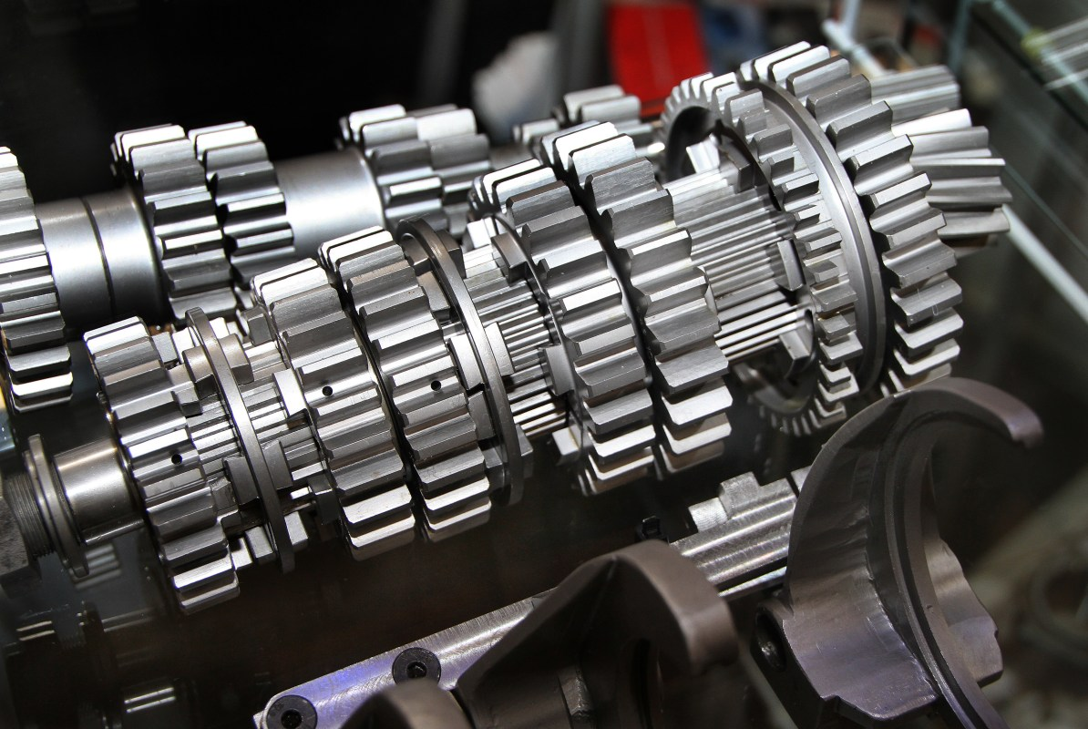 Set of gears from high performance vehicle gearbox.