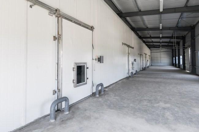 big freezer warehouse at the plant. facade with industrial freezer warehouse door