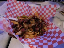 Quebecois: Traditional Poutine with Montreal Smoked Meat and Pickle Chips