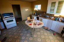 "I don't think it's ""food safe"". Just off the highway I peered into another abandoned home and shot this kitchen."