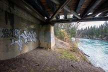 Graffiti under the bridge, and the incredible colours of the Fraser.