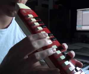 Belio playing the melodica