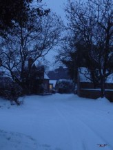 The welcome glow of a friendly kitchen window seems to add to the serenity of deep winter twilight.