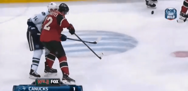 Nino Niederreiter elbows Alex Burrows in the head.
