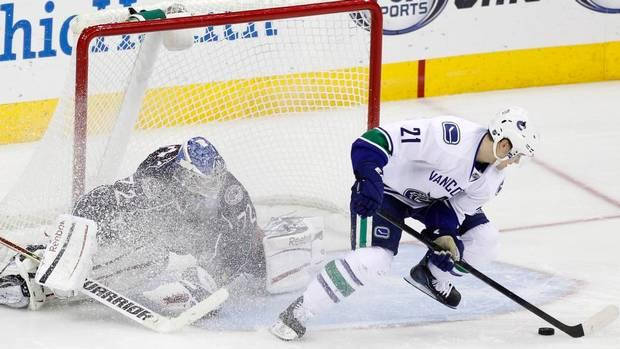 Mason Raymond of the Vancouver Canucks scores a spinorama goal in the shootout to beat the Columbus Blue Jackets.