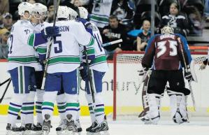 Vancouver Canucks celebrate a goal against the Colorado Avalanche