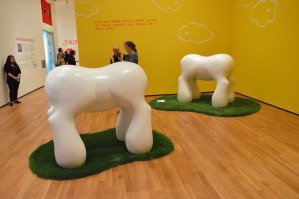 """Three of these molar-like, painted fiberglass """"50-Foot-Tall Scale Models of Proposed Farewell Arches to Luxembourg City"""" rule patches of artificial grass at the Akron Art Museum. PHOTO 