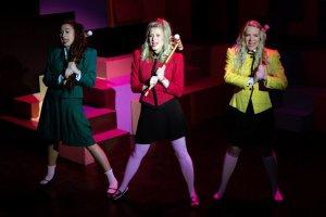 Tia Karaplis as Heather Duke, from left, Kayla Heichel as Heather Chandler and Amy Kohmescher as Heather McNamara. PHOTO | Patrick R. Murphy/PRM Digital Productions