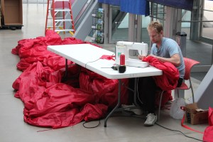 "Jimmy Kuehnle repairs a portion of ""Wiggle, Giggle, Jiggle"" prior to installation at the Akron Art Museum."