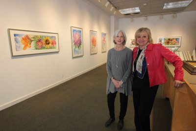 "Gallery director Marcia Hall, left, and office manager Olga Merela inside Bonfoey Gallery during its spring exhibition, ""George Mauersberger: Modern Botanicals."""