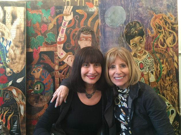 Pennello Gallery co-directors Jacquie Meyerson, left, and Sue Cahn in front of artwork inside their gallery. Submitted photo.