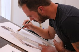 """Sweeney works on a new piece, """"Gold,"""" in his studio."""