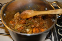 Add the cooked vegetables and peanuts and stir