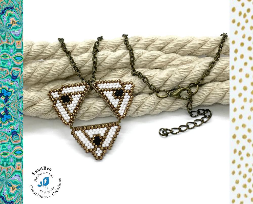 Pendentif en perles tissées blanc et bronze