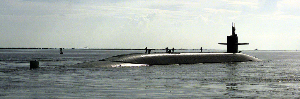 The US Navy's nuclear powered ballistic submarine, USS RHODE ISLAND (SSBN 740), leaves for an Atlantic patrol mission out of Kings Bay, Georgia. (Photo by Patrick Nugent, USN Civ. [Public domain], via Wikimedia Commons)