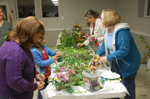 Members use flowers, foliage, berries, and seed heads to create floral centerpieces