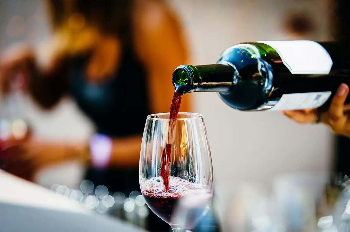 Sommelier Pouring Wine for Wine Club Members