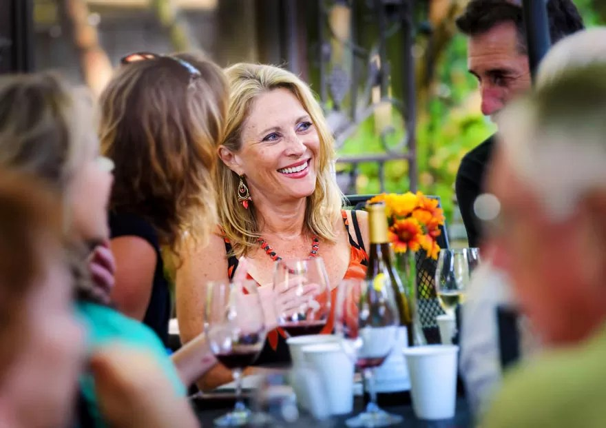 South Stage Cellars Wine Garden Guests with Flowers