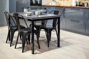 A kitchen with a dining table, great for making an international relocation checklist.