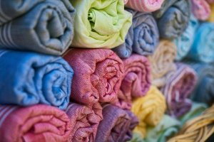 Many towels wrapped in bundles.