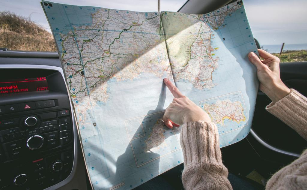 pointing to road map