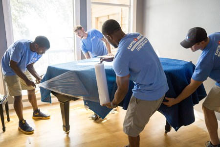 Four-Men-Capital-Movers-Texas-Movers-Wrap-Piano-Covered-Blanket-With-Plastic