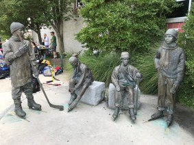 The statues outside The Gardens Ice House.
