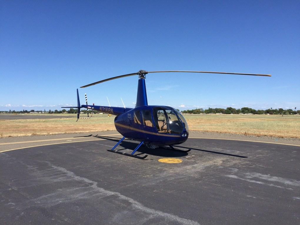 The Robinson R44 Raven II on the tarmac at Sacramento Executive Airport
