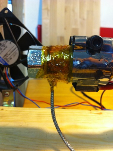 Assembled nozzle head. Some Kapton tape to hold the temperature probe in place