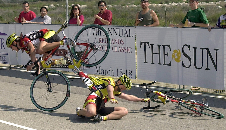 (3-14-01) Team Saturn members Lyne Bessette, left, and Ina Teutenberg, right, collide at the finish line of Wednesday's Stage 2 of the Redlands Bicycle Classic. SAN BERNARDINO SUN STAFF PHOTO BY Rodrigo Pe–a.