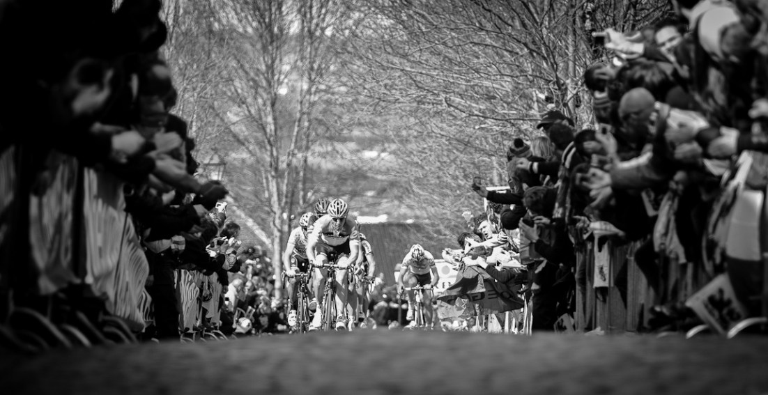 Main peloton leading the charge up the summit of Oude Kwaremont. Tom Boonen from Omega Pharma Quickstep and Flippo Pazzato from Farnese Selle Italia behind Garmin Cervelo rider.