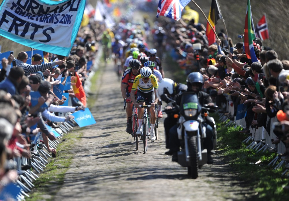 The pack rides during the 113th edition of the Paris-Roubaix Paris-Roubaix one-day classic cycling race on the section of the route known as the Trouee d'Arenberg (Tranchee de Wallers-Arenberg) in Wallers on April 12, 2015. AFP PHOTO / FRANCOIS LO PRESTI (Photo credit should read FRANCOIS LO PRESTI/AFP/Getty Images)