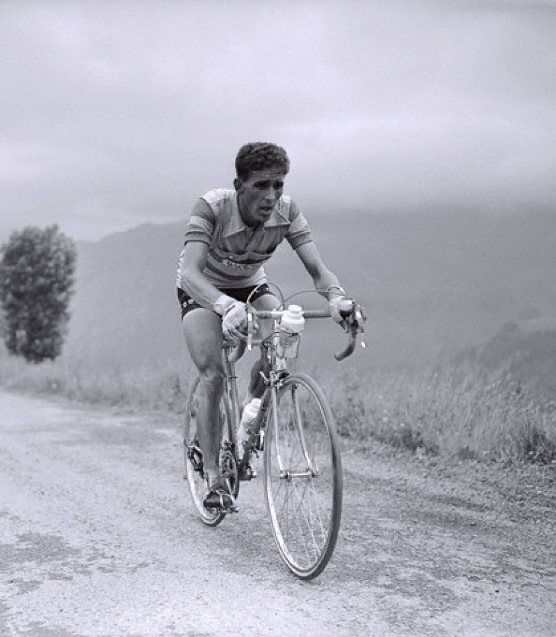 16 Jul 1956, Between Bayonne and Pau, France --- During the 11th stage of the 1956 Tour de France between Bayonne and Pau. Spanish cyclist Federico Bahamontes, known as The Eagle of Toledo, races during the Aubisque ascent. --- Image by © Universal/TempSport/Corbis