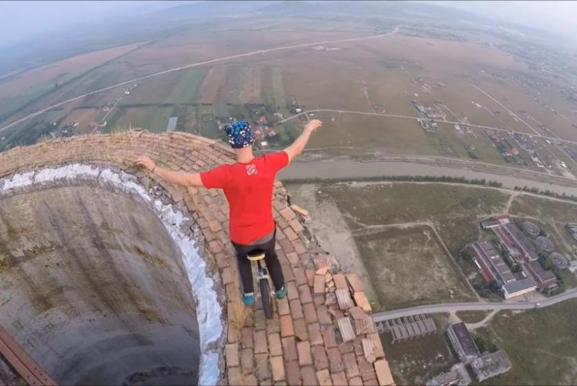 Daredevil-unicyclist-performs-tricks-atop-840-foot-chimney