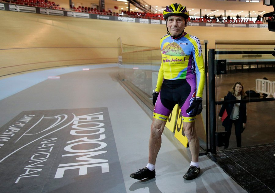 French cyclist Robert Marchand, aged 102, walks onto the track at the indoor Velodrome National in Montigny-les-Bretonneux, southwest of Paris January 31, 2014. Marchand set a new record, cycling 26.98 kms in one hour, in the Masters + 100 category established by the International Cycling Union (UCI). REUTERS/Jacky Naegelen (FRANCE - Tags: SPORT CYCLING SOCIETY TPX IMAGES OF THE DAY) ORG XMIT: JNA107