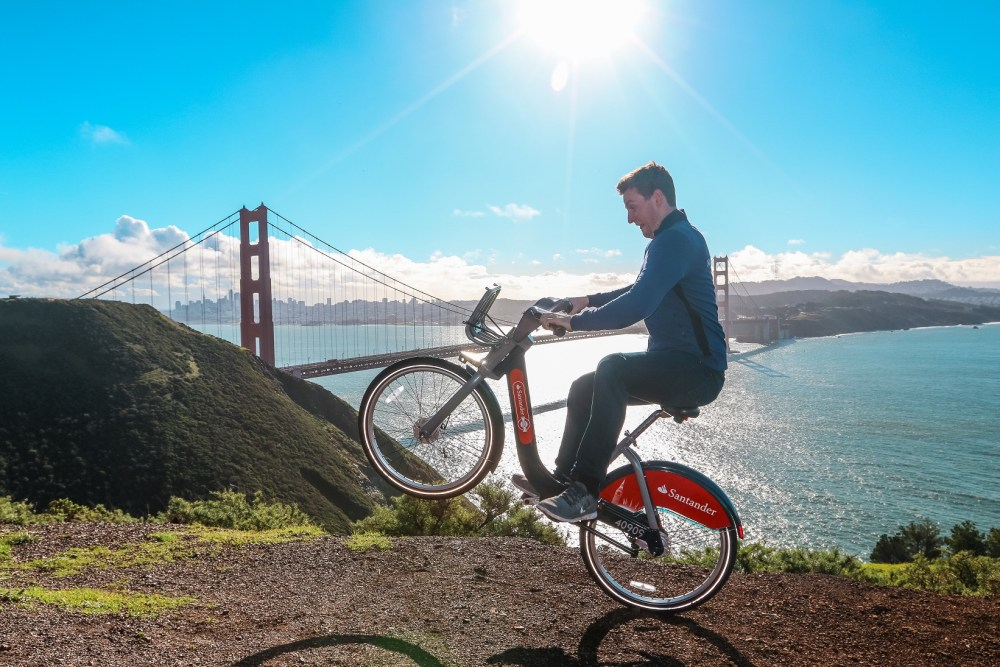 Chris Astil-Smith, 24 (L) with his The Boris bike in San Francisco. See National copy NNBIKE: A biking mad entrepreneur made a round the world cycling trip - on a Boris bike. Chris Astil-Smith, 24, rented the Boris bike and cycled around seven cities including New Delhi, Las Vegas and Paris. For three weeks in January Chris cycled around five countries and spent two days in each city capturing the trip with friend and videographer Alex Tyrwhitt. He faced security trouble in New York as well as Delhi where the entrepreneur was forced to bribe security £10 at the Taj Mahal to cycle inside.