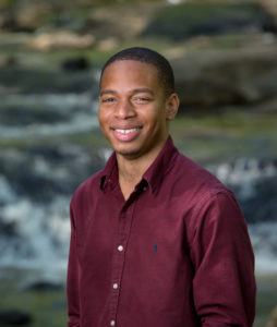 """Denzell Cross - PhD candidate in Ecology Denzell Cross awarded Ford Foundation Predoctoral Fellowship Athens, Ga. – Denzell Cross, a doctoral student in Integrative Conservation and Ecology at the University of Georgia, has been awarded a Ford Foundation Predoctoral Fellowship. This highly selective award—approximately 65 were given in 2018—provides three years of support for study in pursuit of a doctorate. It recognizes academic excellence; promise for future achievement as a scholar, researcher and teacher in higher education; and capacity to use diversity as a resource to enrich the education of all students. Cross is the fourth UGA student to receive the award.  Cross studies the impacts of landscape-scale disturbance on urban watersheds in Georgia using trait-based ecology and historical data. Specifically, he is exploring how the structure and function of communities of macroinvertebrates—small creatures like insects, crayfish and snails—living in streams and rivers change through time in response to increasing urbanization.  His work will help inform management and conservation efforts in urban environments. """"Denzell has been such a fantastic addition to my lab and to the Odum community,"""" said Cross's doctoral advisor Krista Capps, assistant professor in the Odum School of Ecology and Savannah River Ecology Laboratory. """"His proposed work has the potential to fundamentally change how we understand the long-term impacts of urbanization on animal communities. The recognition of Denzell's potential as a scientist from the Ford Foundation is wonderful and exceptionally well-deserved."""" The doctoral program in Integrative Conservation combines disciplinary depth in one of four areas—anthropology, ecology, geography or forestry and natural resources—and collaboration across disciplines and fields of practice, with a focus on solving the complex conservation challenges of the future.  """"Denzell is a perfect example of the kind of s"""