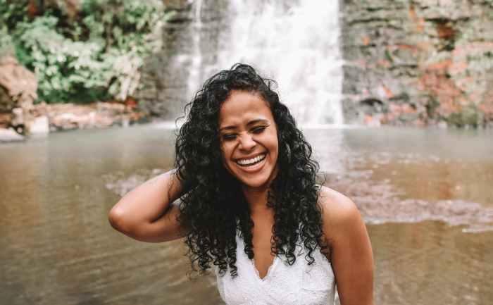 happy black woman near waterfall