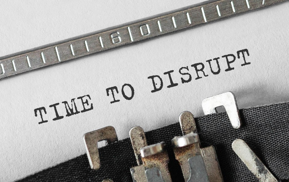 "Typewriter ribbon with paper, reading ""time to disrupt"""