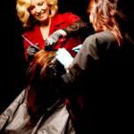 Instructor and Student Applying Hair Color to a Client