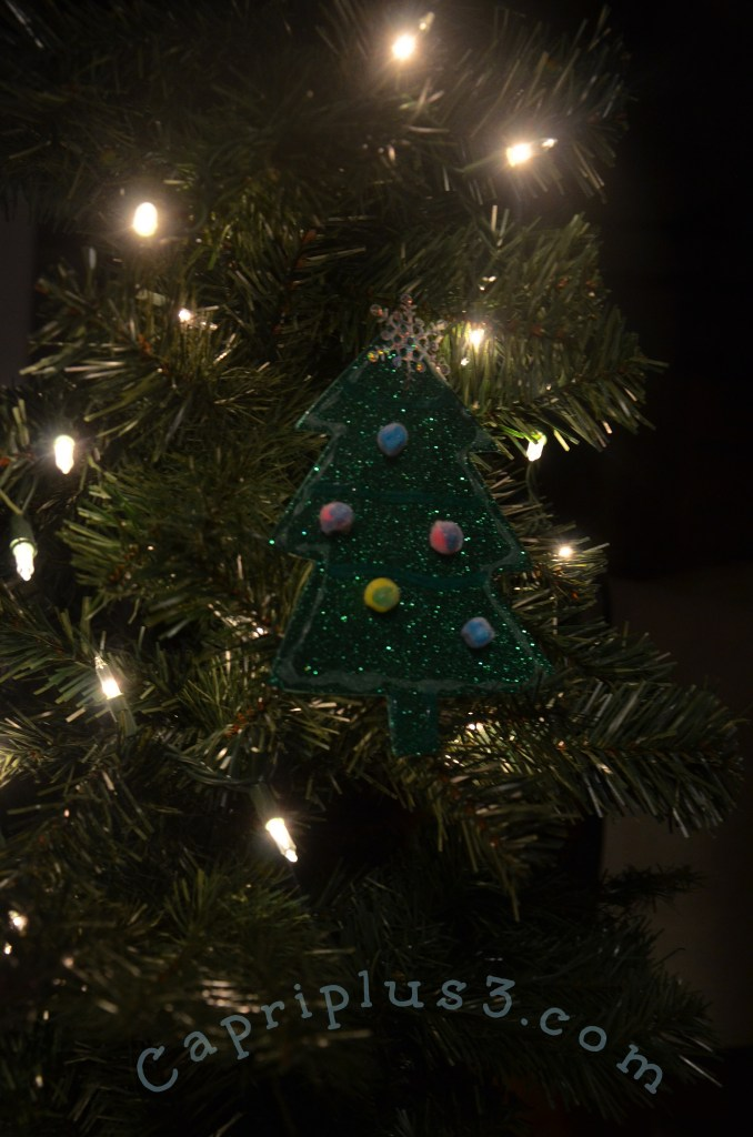 This image has an empty alt attribute; its file name is Glow-in-the-Dark-ornament-on-tree-678x1024.jpg