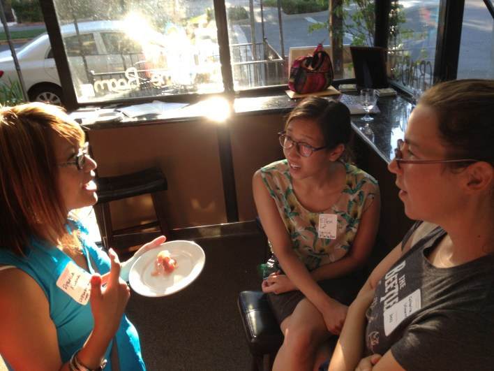 Becca Kwong, Ellen Lê and Katharina Ullmann discuss the importance of library science to researchers and communicators at the June 20, 2013 networking social.