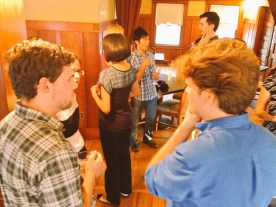 James Eldred (left), Nick Gray (right), and other members mingle at the CapSciComm meetup on July 29th, 2015. (Image Credit: Ben Young Landis)