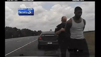 Video from WRBL-TV shows Auburn's QB in cuffs