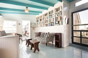 living room and a full bookcase for readers