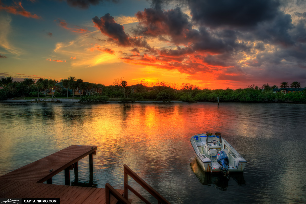 boat dock on waterway during sunset in north palm beach