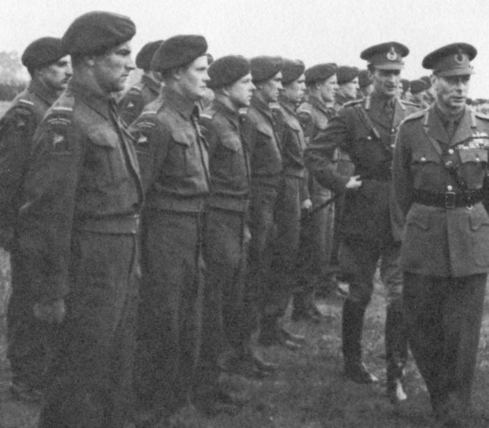 """C"" Coy 1 Canadian Parachute Battalion and King George VI May 1944 Two snipers are in the front rank. Pte. Peter Braidwood (2nd from left) and Pte. Cliff Douglas (3rd from left)"