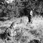 Two snipers. One advances while the other one covers him. This MAY be 1944-10-09 the Scout Platoon of the Queen's Own Cameron Highlanders of Canada at Fort de Brasschaat, Belgium
