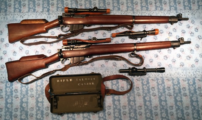 "Long Branch No. 4 MK.I* (T) Trade Pattern. Two of the 350 sniper rifles built by Canada that were fitted with U.S. made Lyman Alaskan No. 32 TP MK. I scope. Both sets are matching. The two ""orphaned"" scopes are originals. The upper one is in a Roger Payne replica slide and the bottom one is in an original slide. The scope case C No. 18 MK. I matched the bottom rifle with its scope."