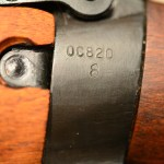 "Socket showing the serial number 0C820 over the U.S. Ordnance flaming bomb. No year here. The early Stevens-Savage rifle had the year on the left sidewall (1941 or 1942). These 1,403 rifles did not have the ""TR"" stamp."